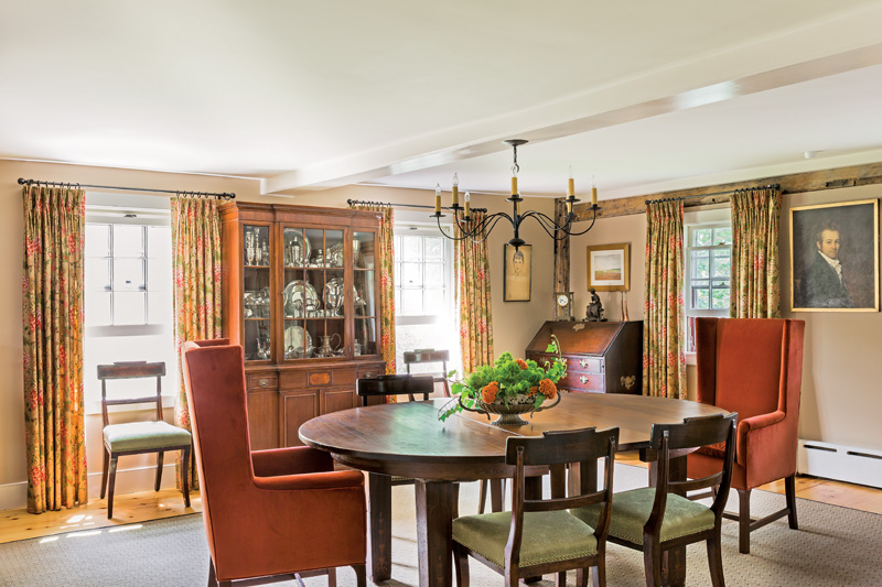 The oldest room is used as the dining room. Sally Wilson chose its furnishings to provide a warm backdrop for winter holidays.