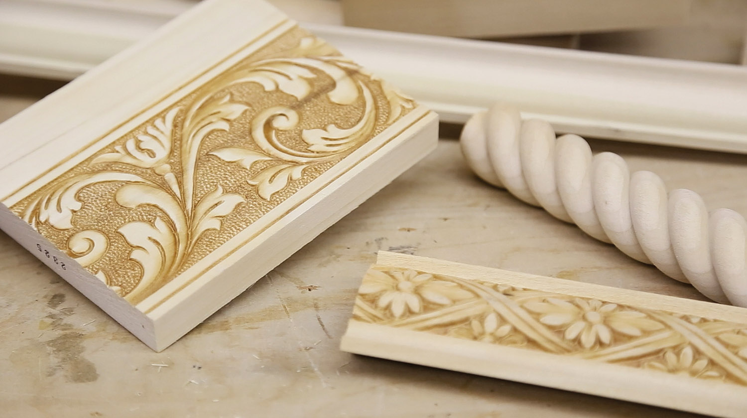 Examples of embossed mouldings, made using pressure and heat.