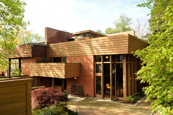 Each of four brilliantly sited units features brick, glass, and cypress siding.