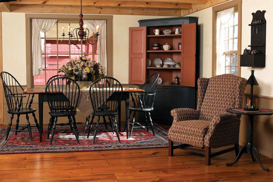Painting wainscots, trim, and freestanding furniture in milk paint helps tie elements in a reproduction home together, giving it an authentic early American feel.