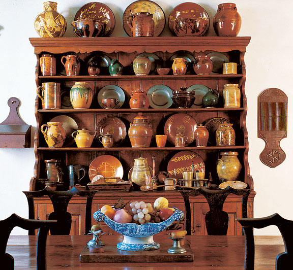 Redware fills a dresser at Cogswell's Grant, an 18th-century farmhouse with a large folk-art collection. (Photo: Sandy Agrafiotis)