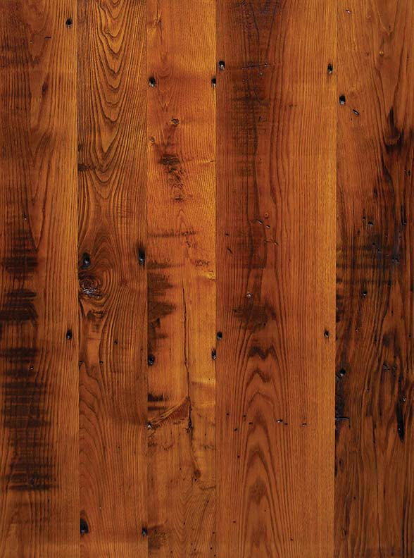 Reclaimed chestnut skip-planed for character from Longleaf Lumber.
