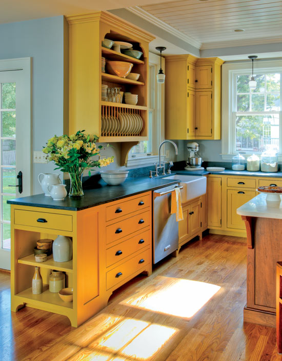 Crown Point Cabinetry used a custom-blended milk paint for these Shaker-inspired cabinets.