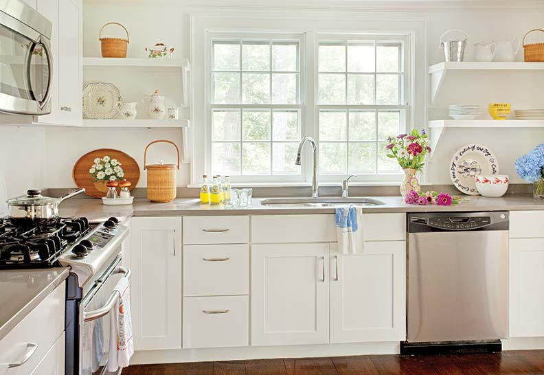 Simple open shelving, reclaimed flooring, and energy-efficient appliances create a sweet and sustainable kitchen.