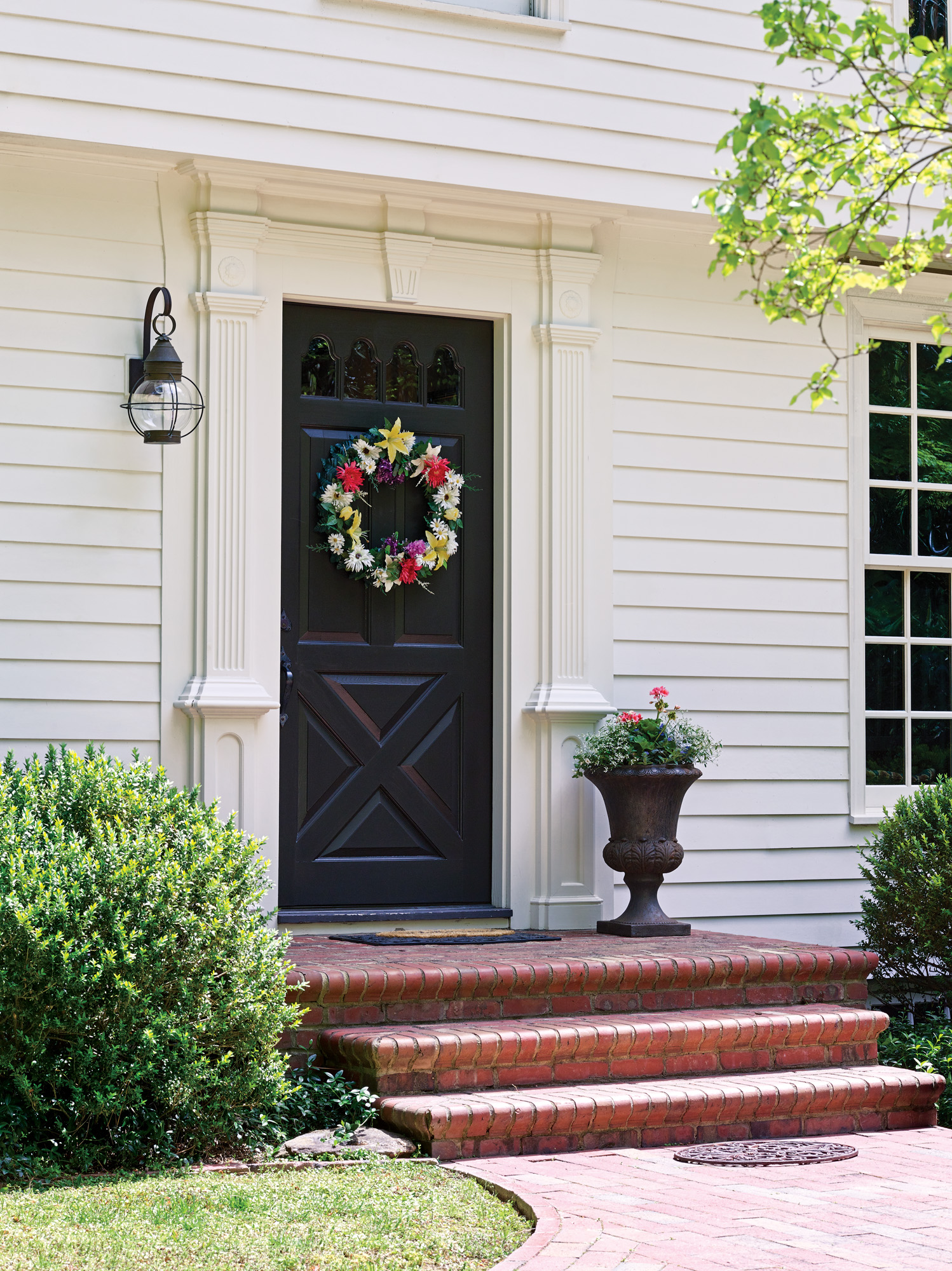 A very plain entry door was replaced with this Colonial Revival surround and batten door.
