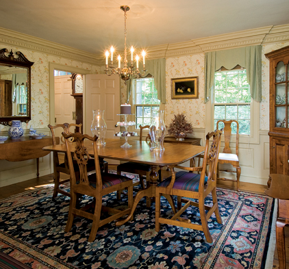 Mid-Atlantic 1750s high style lives in a dining room defined by tiger maple furniture and tender rococo colors. Canton ceramics on the sideboard provide a nod to formal, late 18th-century New England decor.