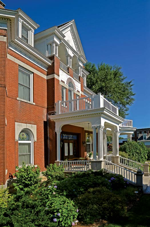 With heavy Colonial Revival influences, the 8,000-square-foot Queen Anne house is a landmark in the small community.