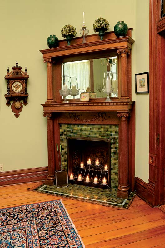 An original fireplace highlights a corner of the formal dining room.