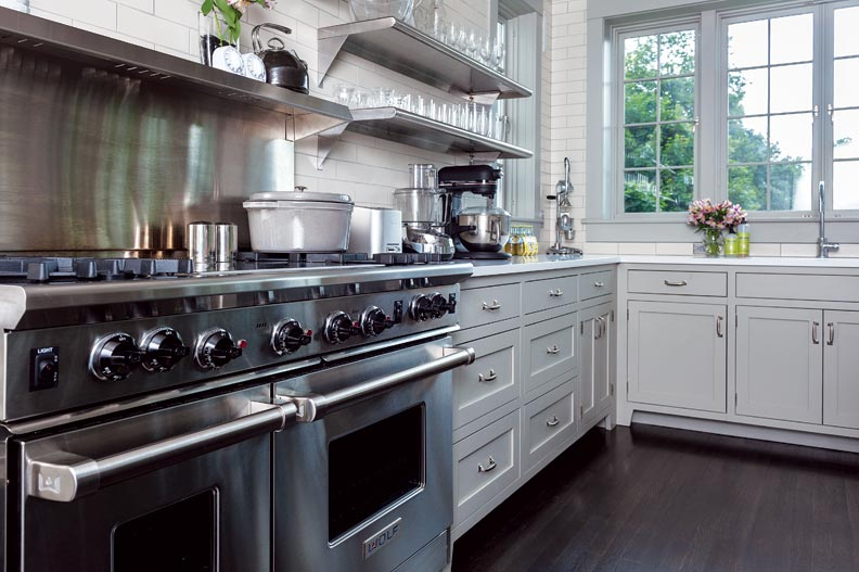 Modern stainless steel appliances tie the space to the 21st century.