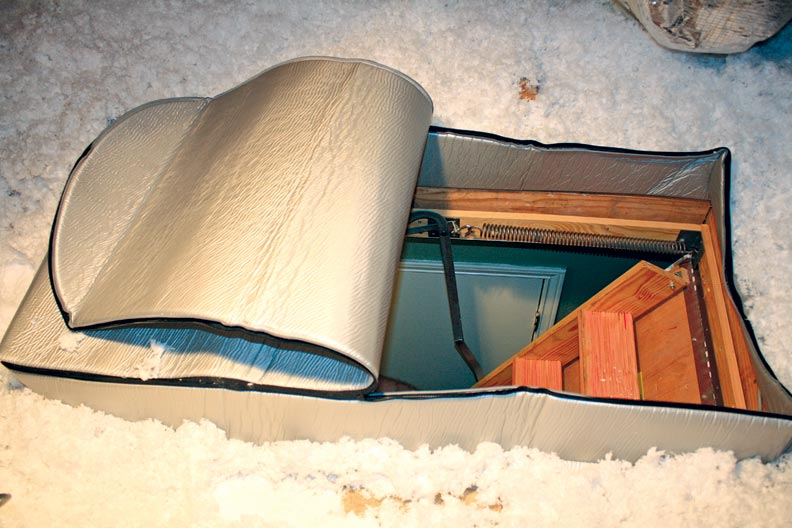 Adding an insulator to the attic access, like this one from Attic Covers, keeps drafts out of the house.