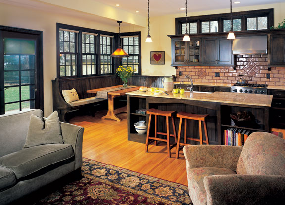 Eric, who creates furniture under the mantle Feenix Design, designed the kitchen's island and built-in banquette.