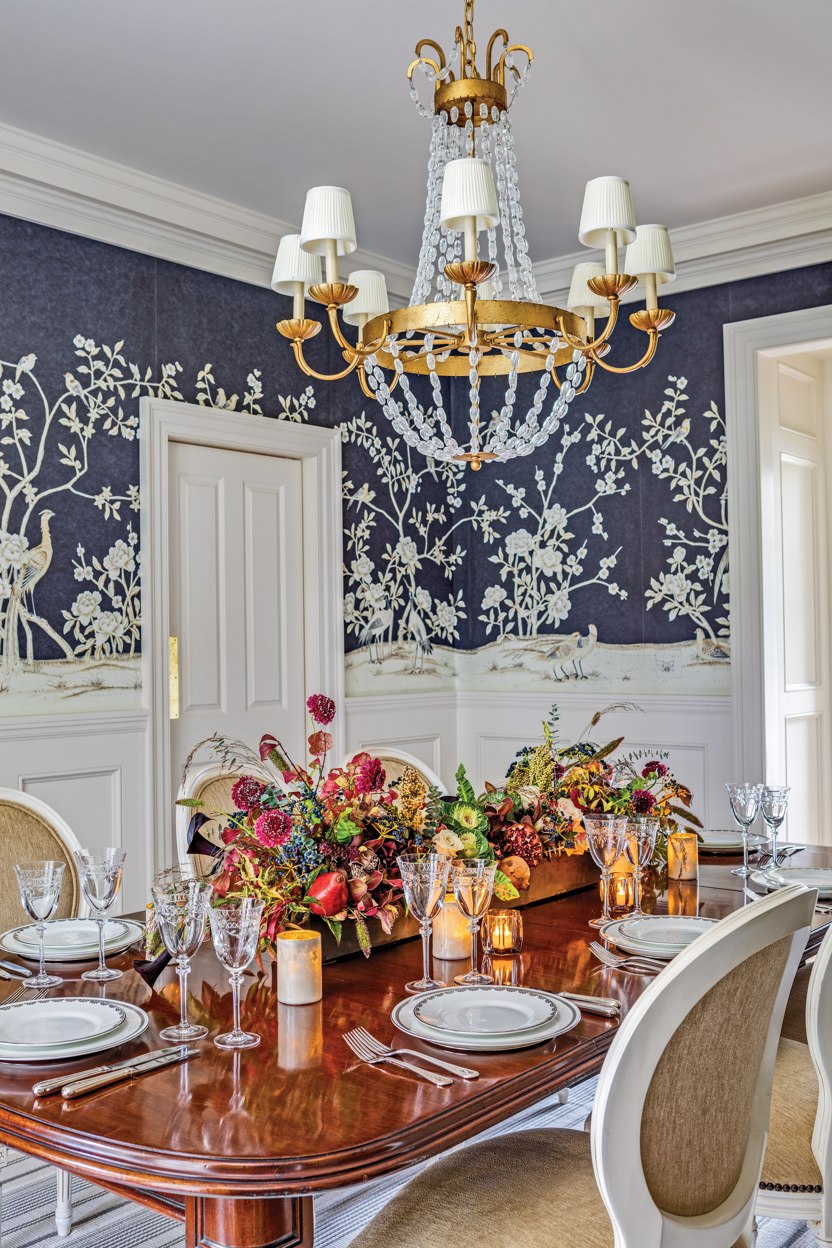 An antique chandelier lights the dining room.