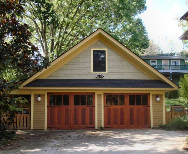Evergreen Carriage Doors split the expanse into two bays for a more historical look.