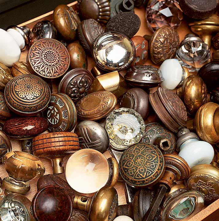 Evidence of Chris Wilson's restoration passion: a collection of old doorknobs displayed in a cabinet by the front door.