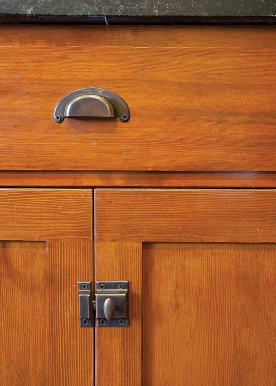 The unpainted Douglas fir cabinets brought up a struggle between the author's desires and period authenticity.