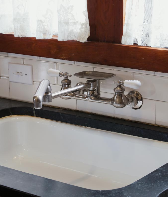The wall-mounted bridge faucet was procured after an exhaustive search.