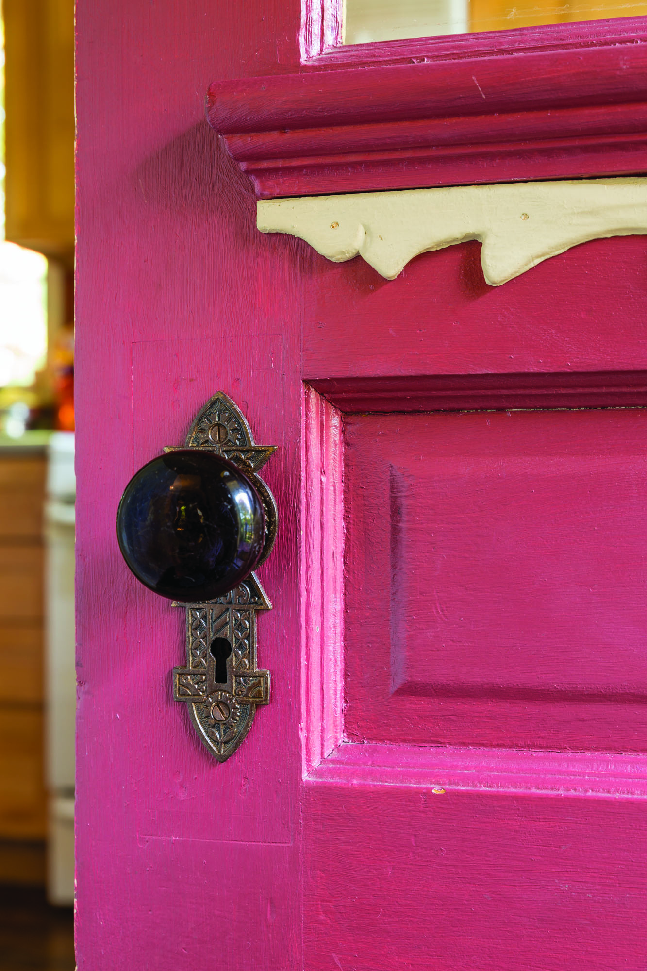 Original locksets were stripped and restored; the back door has panels with mouldings and a decorative onlay.