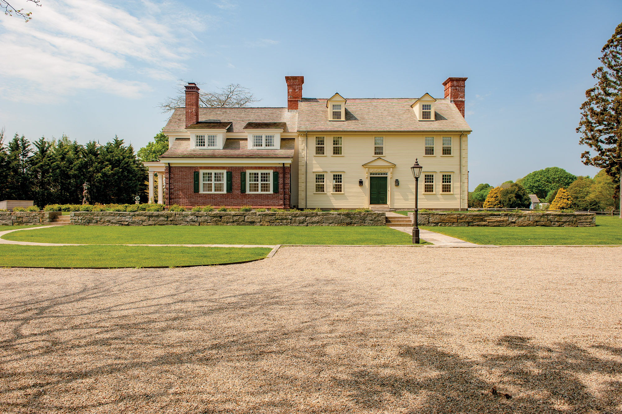 A brick-front addition joined the restored 18th-century Pendleton house in Rhode Island.