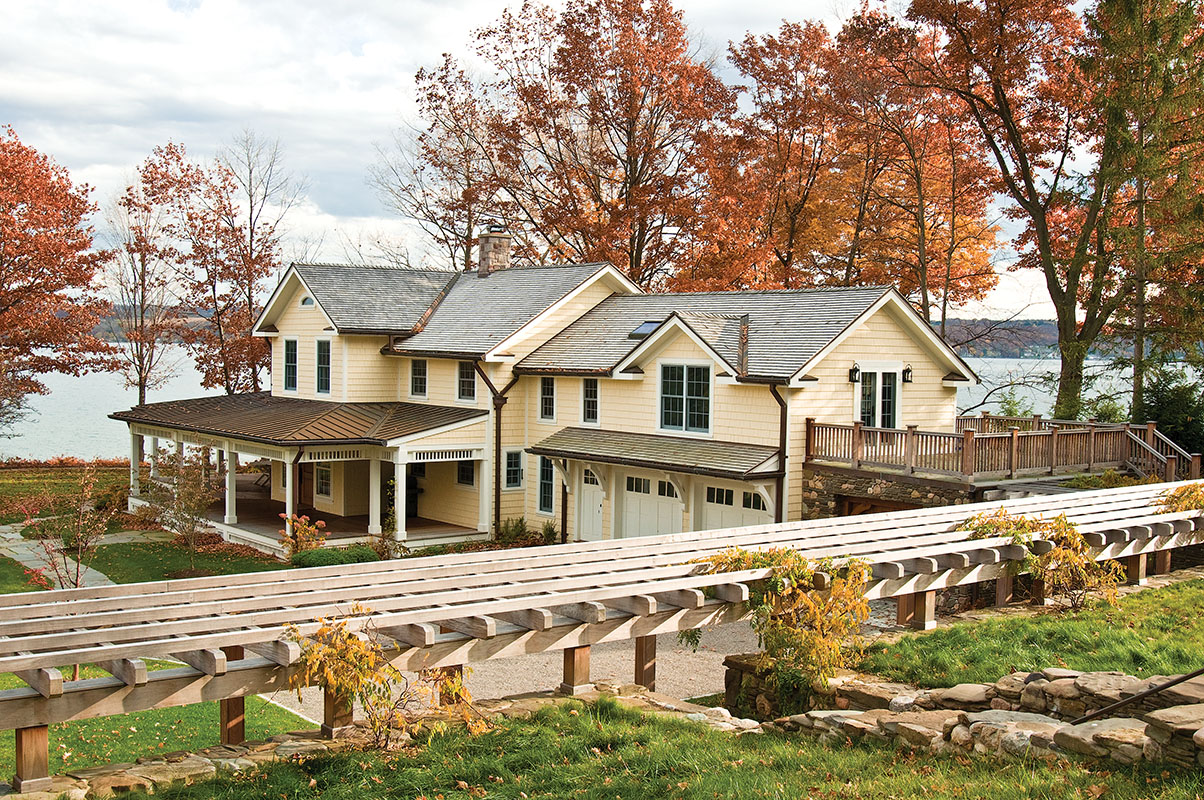 This is a view of the old lake house from the west side: a new pergola connects guest house and main house.