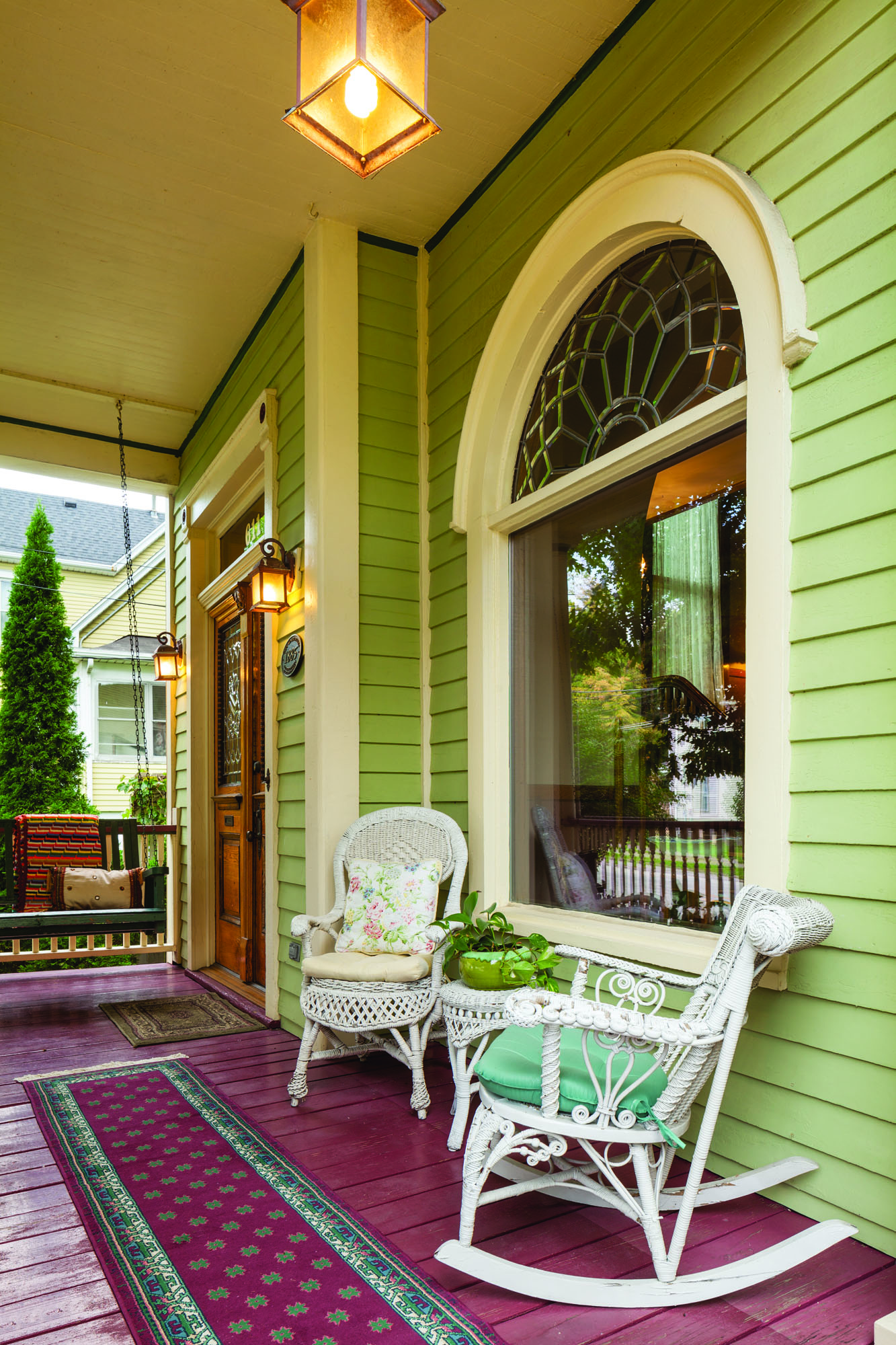 The wide front porch is a favorite spot; children love the porch swing, a replacement made to replicate the original seen in old photographs.