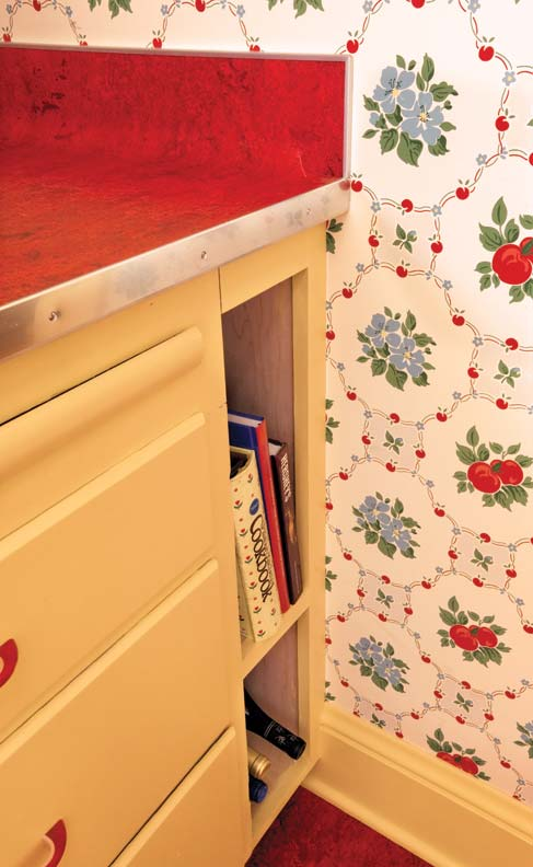 Extra space next to the vintage cabinets became a perfect corner for cookbooks and wine storage.