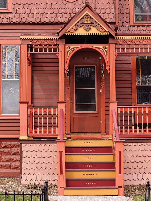 Spandrels are just one of many exuberant details on this 1882 Queen Anne.