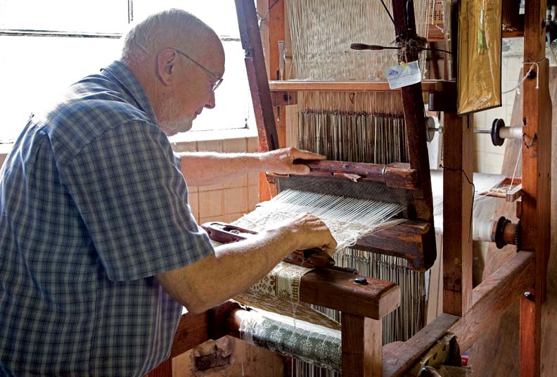 David purchased his first two looms in 1951. Today he has more than 40 looms and 30 employees.