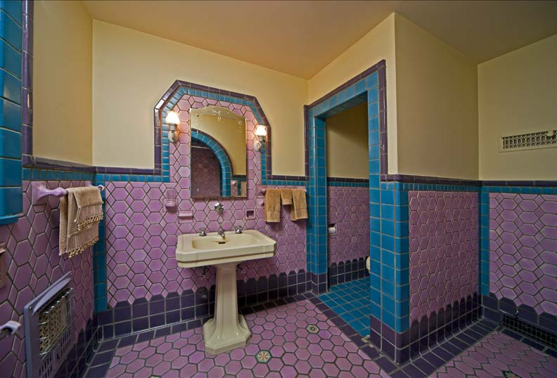 Fancy shapes—including lozenge, diamond, and hexagon tiles—dress up a rose, turquoise, and gray bathroom that's punctuated by a few fancy floral tiles, too.