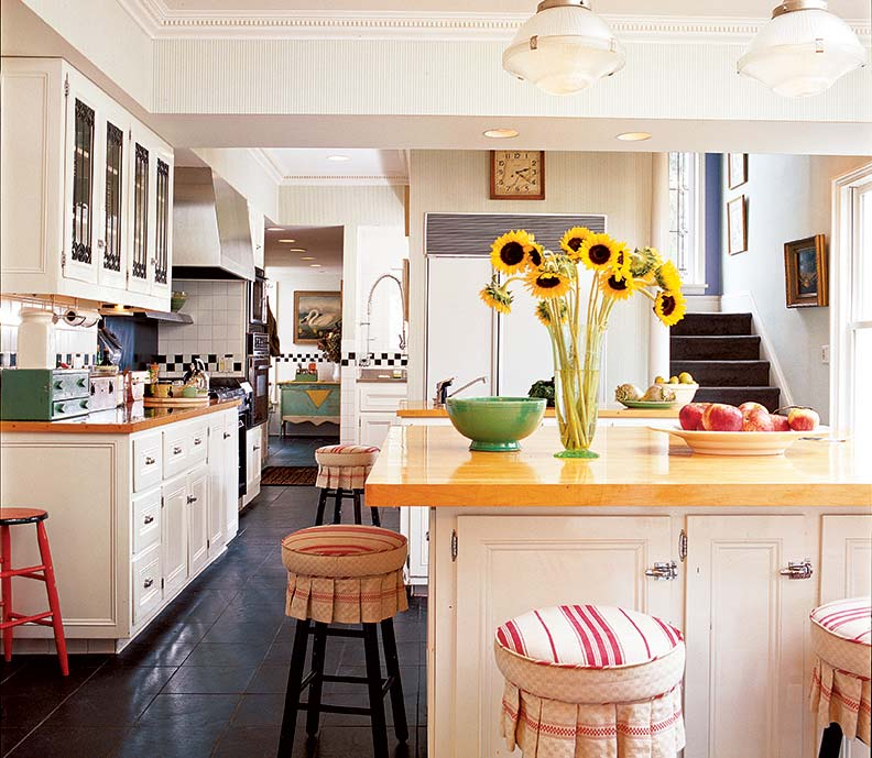 White painted cabinets are timeless for the kitchen in a 1910 addition to a mid