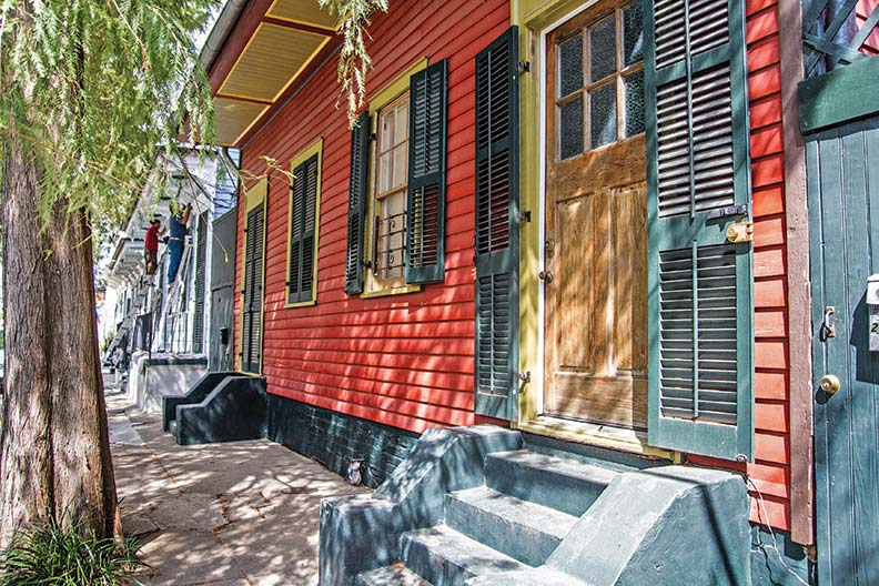 An intact row of Creole cottages, newly painted, on Chartres Street in The Marigny.