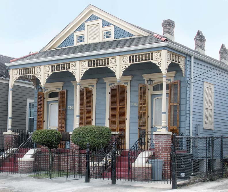 Painted in pastel blue, this classic Shotgun house retains its Victorian embellishments.