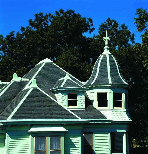 Deep shadows and shades of gray are the essence of slate roofs, and the appearance manufacturers emulate with asphalt shingles. Using multiple layers of laminated asphalt shingles in convincing slatelike shapes reinforces the impression.