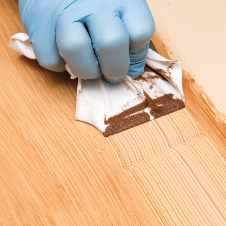 Faux wood graining with a steel comb wrapped in a cotton rag