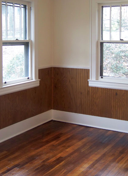 After recoating, this room's formerly scuffed-up hardwood flooring looks good as new.