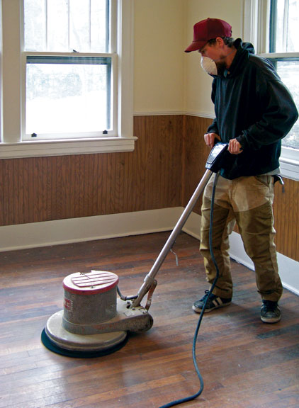 A floor polisher fitted with a synthetic pad will make quick work of scuffing old coatings. (Always wear a protective mask to guard against dust particles.)