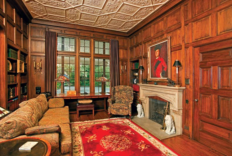 Foor-to-ceiling mahogany paneling defines the library, which is further formalized by an intricate, panelized floral plasterwork ceiling.