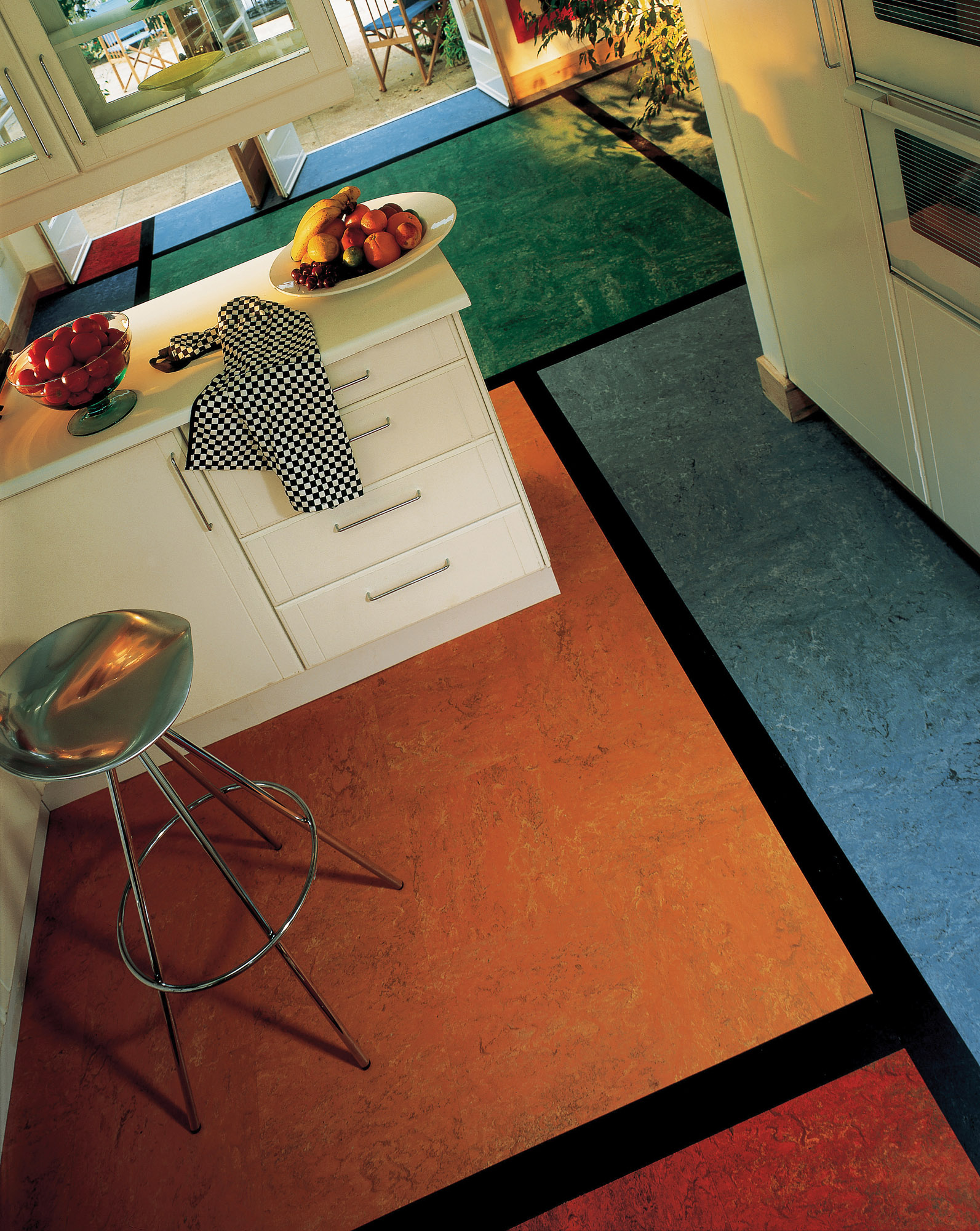 Marmoleum Click. linoleum tiles and sheets come in a broad color spectrum and lend themselves to designs as seen in this color-block floor.
