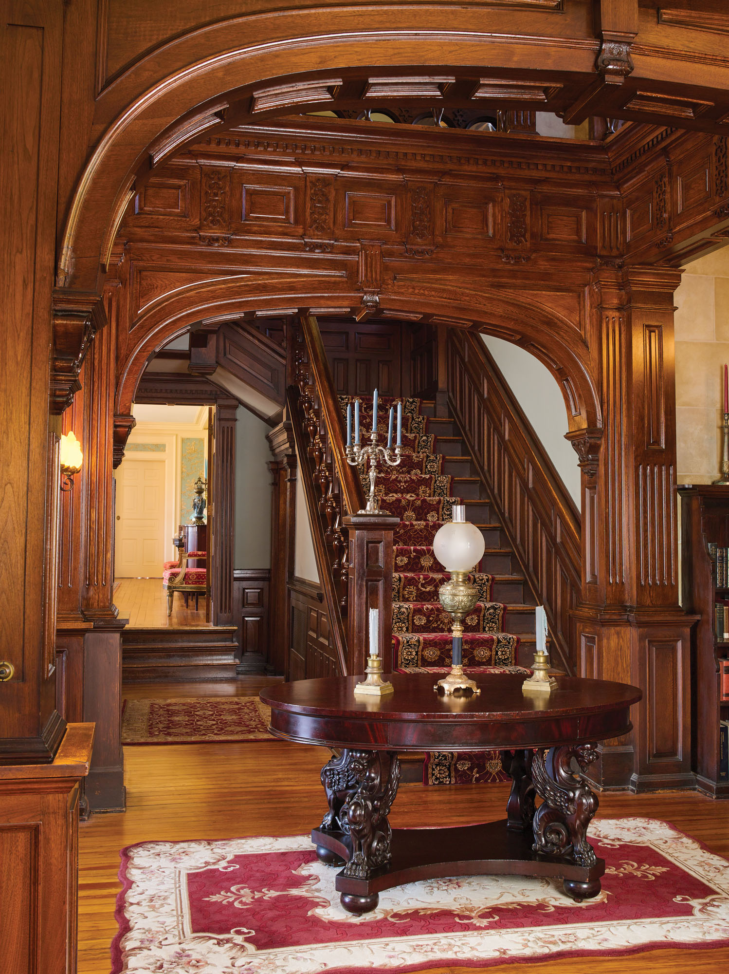 wood central staircase at Forest Oaks