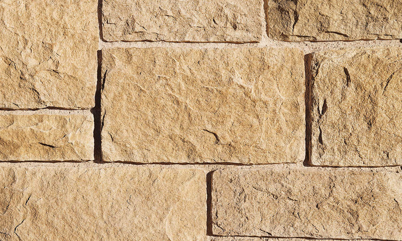 Formal coursed architectural stone veneer that resembles sandstone. (Courtesy: El Dorado Stone)