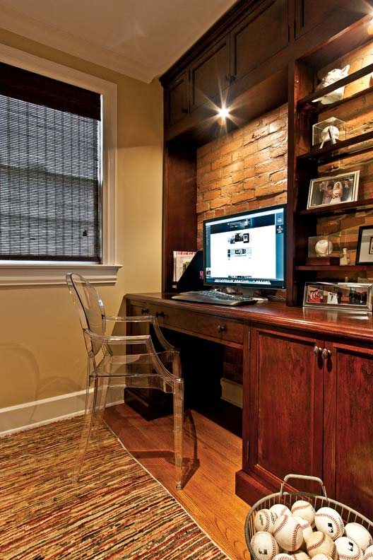 Formerly part of the guest bathroom, the office features a massive built-in desk made by the couple.