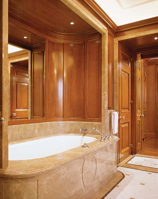 The tub has a convex apron and is crowned by concave paneling.