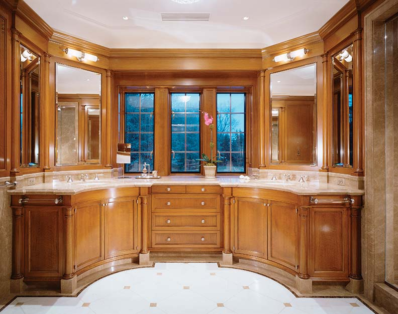 The curved, symmetrical vanity is paneled in anigre.