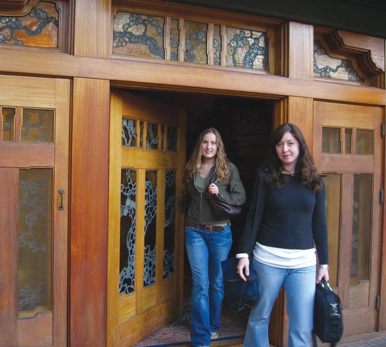 Friends before they were housemates, Jana Cooper (left) and Ewa Ziabek (right) faced stiff competition for the privilege of living at the house. The distinctive wide and low from door has an art glass window depicting the tree of life.