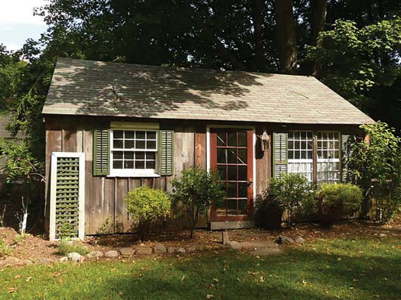 The colors on this shed, which accompanies a sunny 1720s Cape, take inspiration from the garden rather than the house.