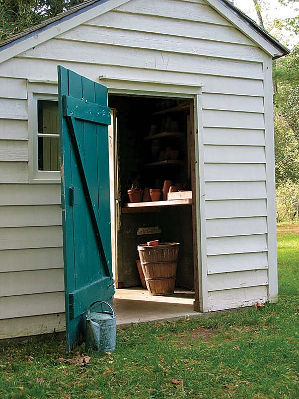 The teal door of the potting shed at Historic Walnford adds an unexpected touch of color.