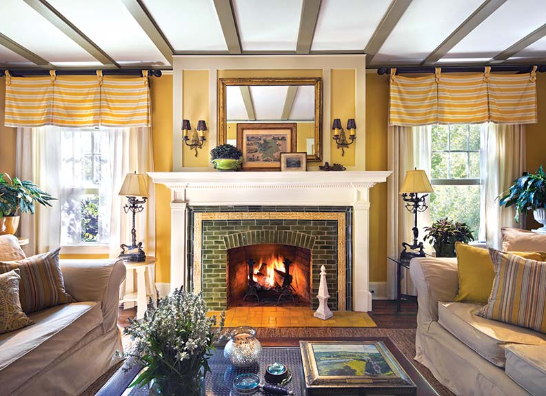 The living room's fireplace is surrounded by green tile—another nod to the Craftsman movement.