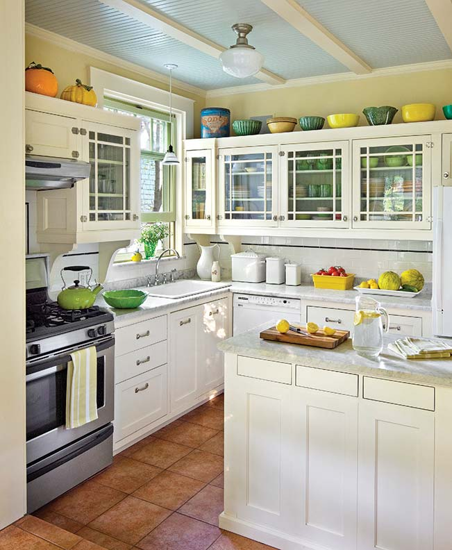 In the kitchen, the linear cabinet door design gives a nod to the Arts & Crafts style.
