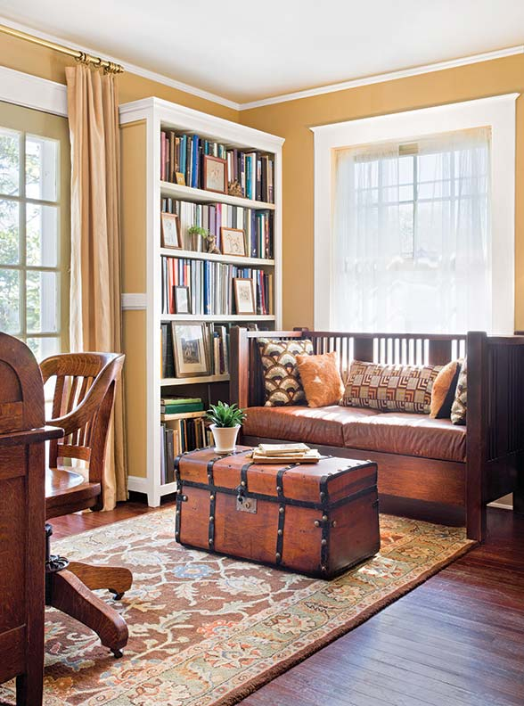 In the study, an old storage trunk is repurposed as a coffee table.