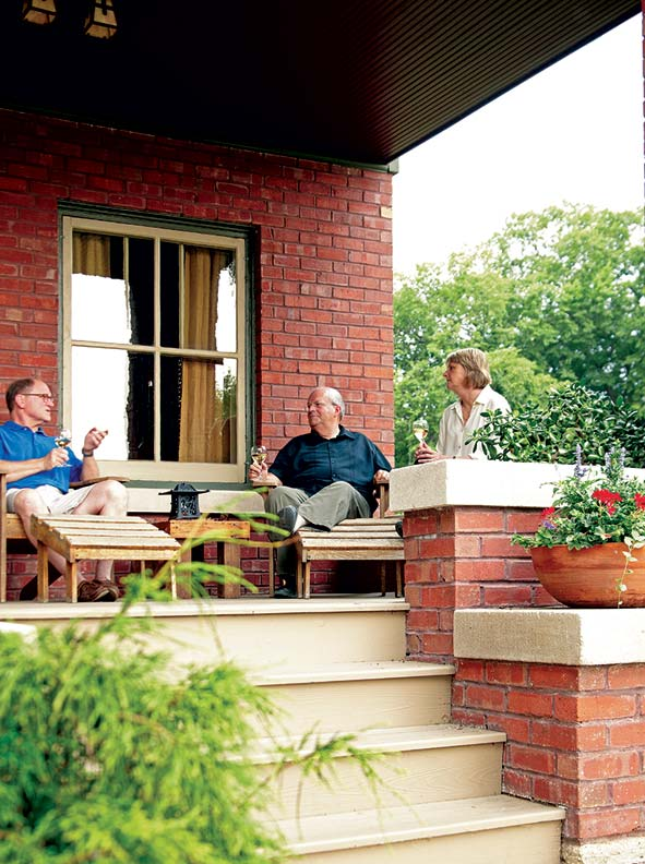 Gary Carlson (center) with Kurt and Sarah Bell on the back porch.