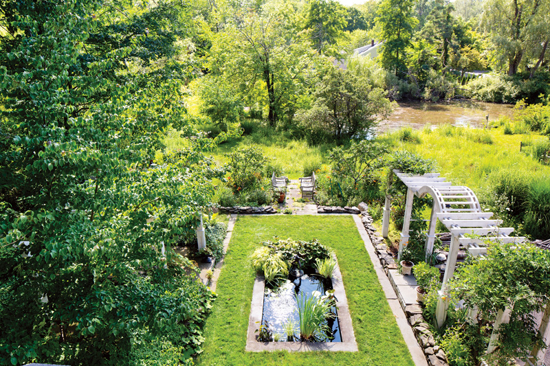 A view from upstairs shows how the garden progresses from axial formality to unrestrained wildness near the pond. bottom: (Photo: Bill Ticineto)